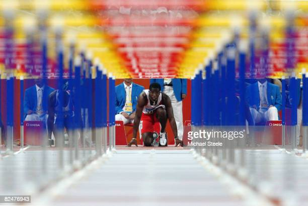 Dayron Robles of Cuba prepares to compete men's 110m hurdles during the track and field athletics event at the National Stadium during Day 12 of the...