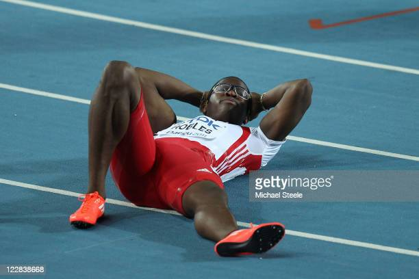 Dayron Robles of Cuba recovers after winning the men's 110 metres hurdles final during day three of the 13th IAAF World Athletics Championships at...