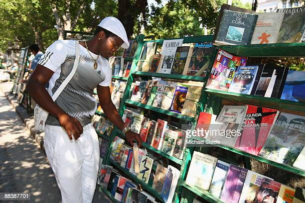 Dayron Robles of Cuba the Olympic champion and world record holder in the 110m hurdles at a book stall in the old town during the 'Iaaf Day in the...
