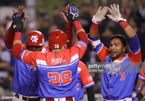 Dayron Varona of Criollos de Caguas from Puerto Rico celebrates with teammates after scoring against Aguilas Cibaenas of Republica Dominicana during...