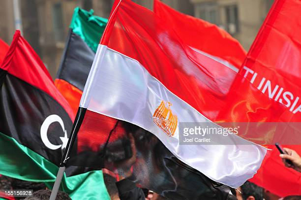 flags of libya, egypt, and tunisia (tahrir square, cairo, egypt) - egypt stock pictures, royalty-free photos & images