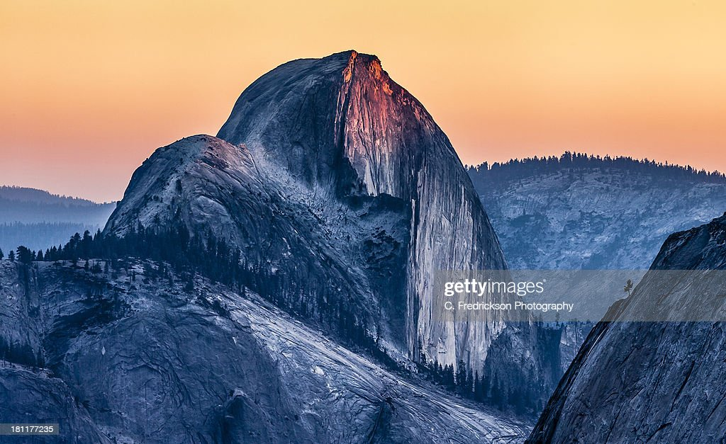 The last of the afternoon sun focused on the top of Half Dome in Yosemite National Park. Shot from Olmstead Point.