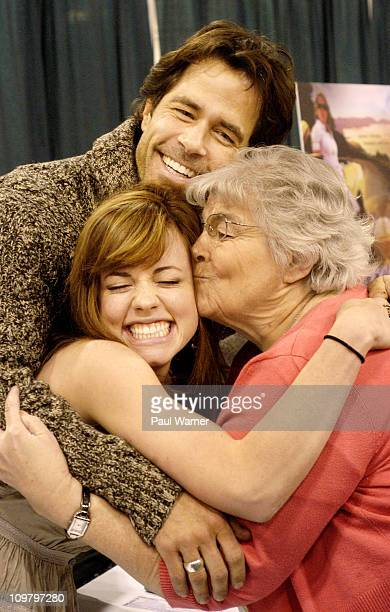 Days of Our Lives fan Barbara Sechrest of Chicago kisses castmember Molly Burnett as cast member Shawn Christian hugs the two as Days of Our Lives...