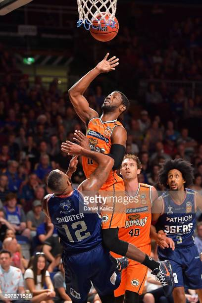 Dayshon Smith of the Taipans drives to the basket over Shannon Shorter of the Adelaide 36ers during the round 11 NBL match between the Adelaide 36ers...