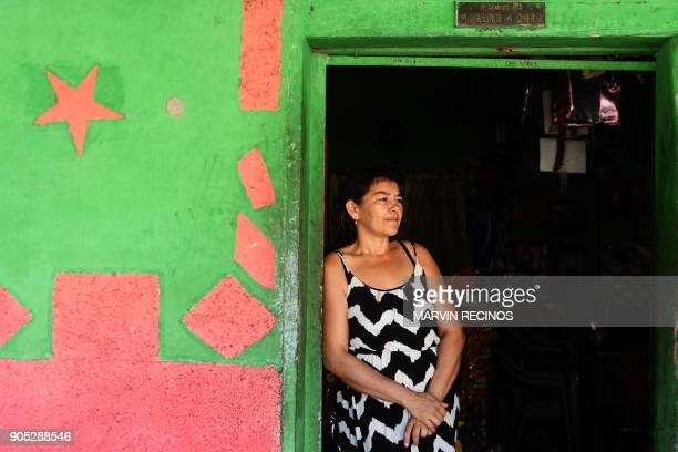 Daysi Moreno who has several relatives living in the US under the status of temporary protection remains at her doorstep in San Isidro municipality...