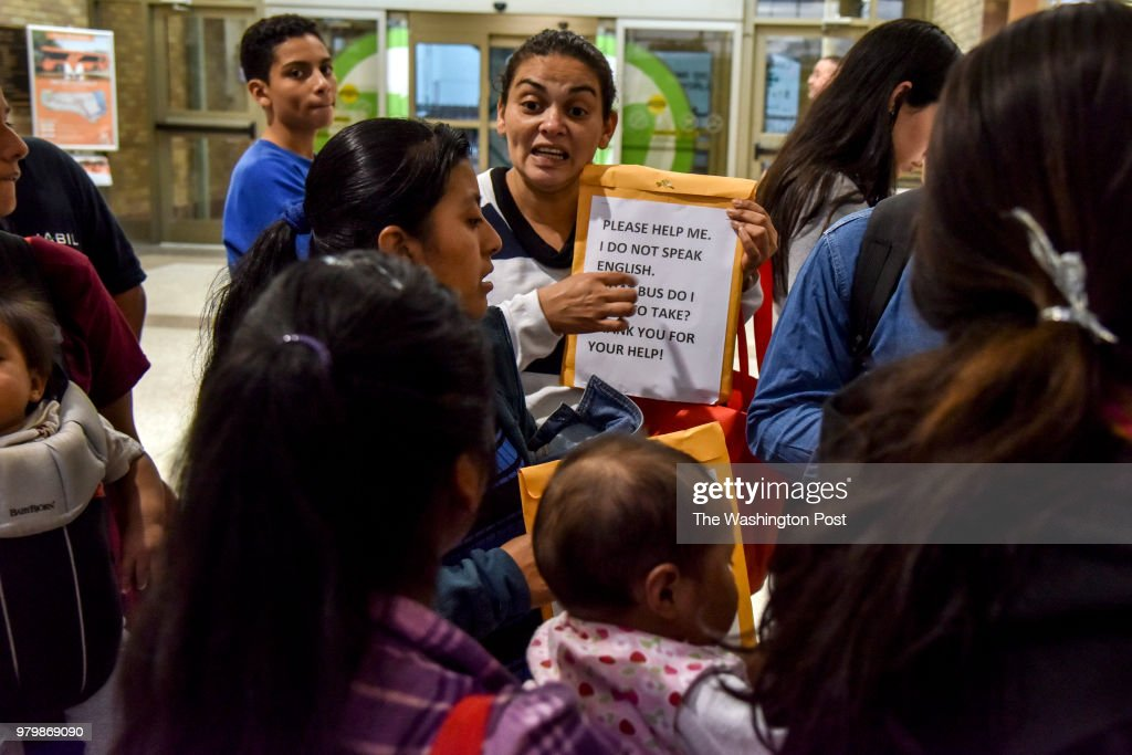 Daysi Salinas (cq) translates a transportation assistance note to fellow migrant families from Mexico and Central America as they wait in line at the Central Station Bus Terminal to obtain bus tickets for transport to various destinations across the United States on Tuesday, June 19, 2018, in McAllen, TX. The families have been granted access to the United States while they await hearings or seek asylum. Waves of migrants from Mexico and Central America continue to seek refuge in the United States amid the growing uproar over the decision to separate migrant families at the U.S./Mexico border.