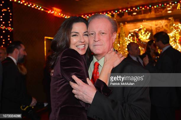 Dayssi Olarte de Kanavos and Patrick McMullan attend George Farias Anne Jay McInerney Host A Holiday Party at The Doubles Club on December 13 2018 in...