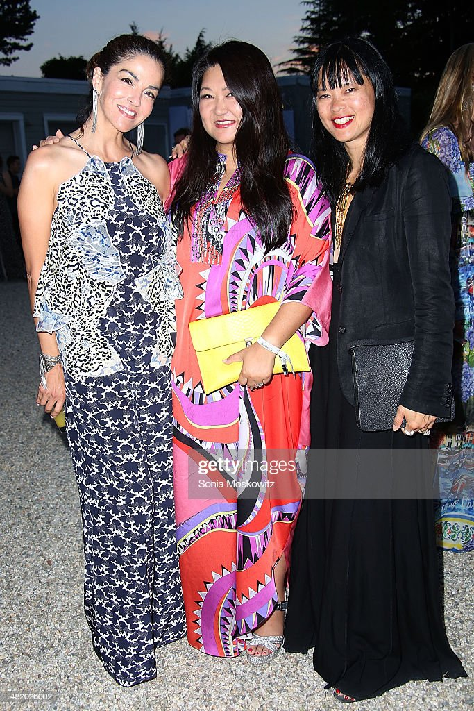 Dayssi Olarte de Kanavos, , Susan Shin and Joanne Ooi attend the 22nd Annual Summer Benefit and Auction at The Watermill Center, 'Circus of Stillness', on July 25, 2015 in Water Mill, New York.