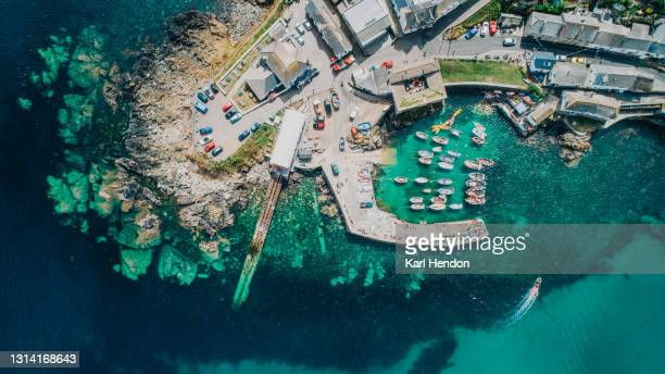 a daytime aerial view of a cornish fishing village - stock photo - passenger craft stock pictures, royalty-free photos & images