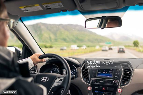 daytime freeway driving through the country - mountain logo stock photos and pictures