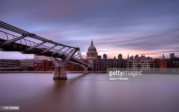 Daytime long exposure of millennium bridge and St Pauls Cathedral London