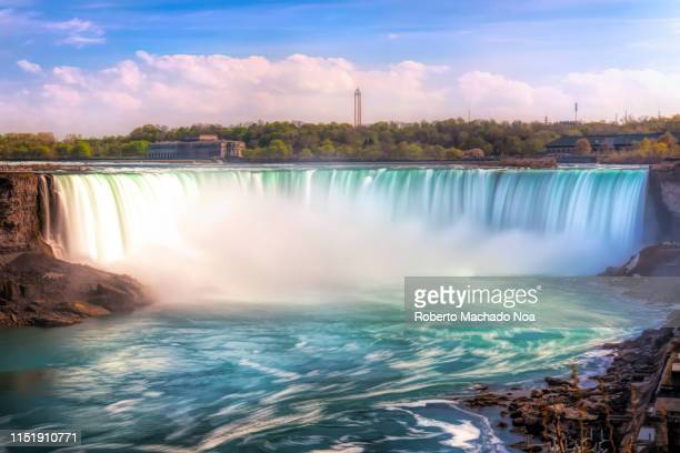 Daytime long exposure of the Horseshoe Waterfall in the Niagara River. The place is one of the most famous tourist attractions in North America....