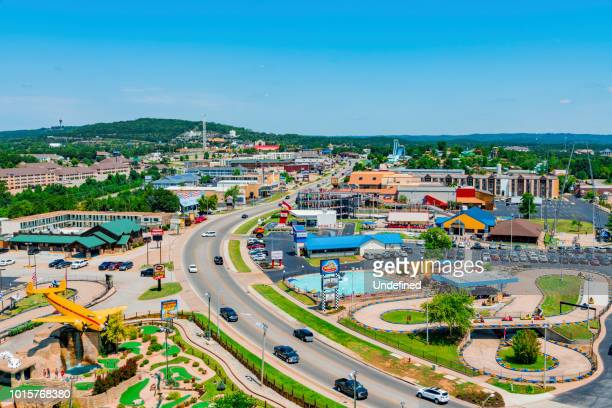 daytime summer aerial view of hwy 76 strip in branson, missouri - ozark mountains stock pictures, royalty-free photos & images