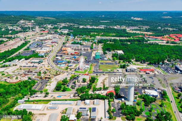 daytime summer aerial view of hwy 76 strip in branson, missouri - 1011957648,1011945618,1011950492,1011960800,1011954950,1011953954,1015768380,1015768366,1015768370,1015768372,1015768382,1015768398,1015768412,1015768410,1015768414,1015768418,1015768438,1015768448,1015768450,1015768488,1015768474,1015768478,1015768504,1015768508,1016083590,1016083634,1016083592,1016083608,1016083686,1016083708,1016083780,1016083774,1016083796,1016083828,1016083994,1016083992,1016083982,1016083980 stock pictures, royalty-free photos & images