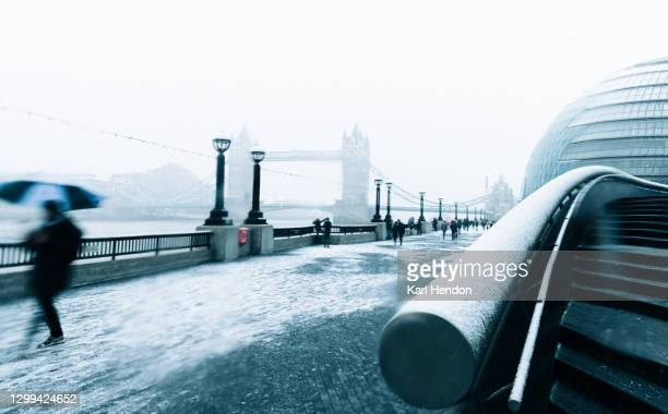 a daytime view london's southbank and tower bridge in the snow - stock photo - mayor stock pictures, royalty-free photos & images