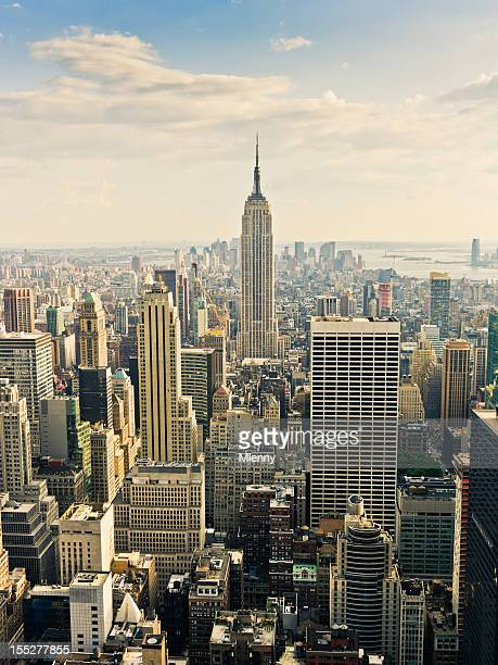 daytime view new york skyline - empire stock photos and pictures