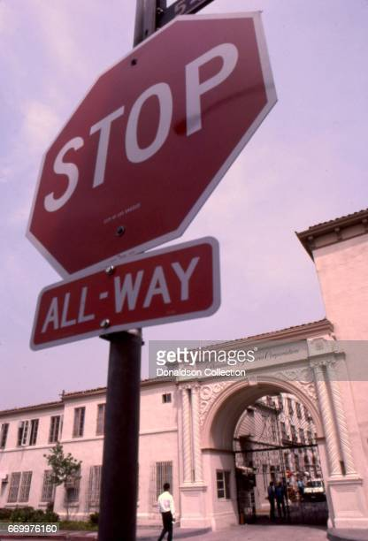 A daytime view of a gate to Paramount Pictures Studios on Santa Monice with a Stop Sign in the foreground in 1989 iin Los Angeles California