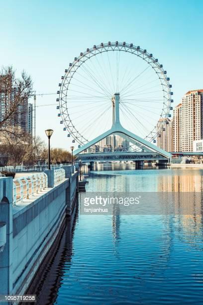 daytime view of giant ferris wheel(Tianjin Eye)over Hai River