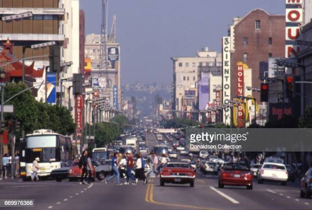 A daytime view of Hollywood Boulevard with a sign for Scientology The Hollywood Wax Museum and Security Pacific bank and cars on the road in circa...
