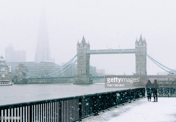 a daytime view of london's tower bridge in the snow - stock photo - politics and government stock pictures, royalty-free photos & images