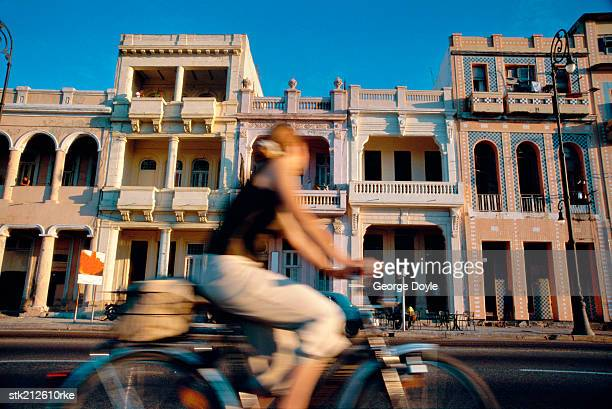 daytime view of malecon and person cycling