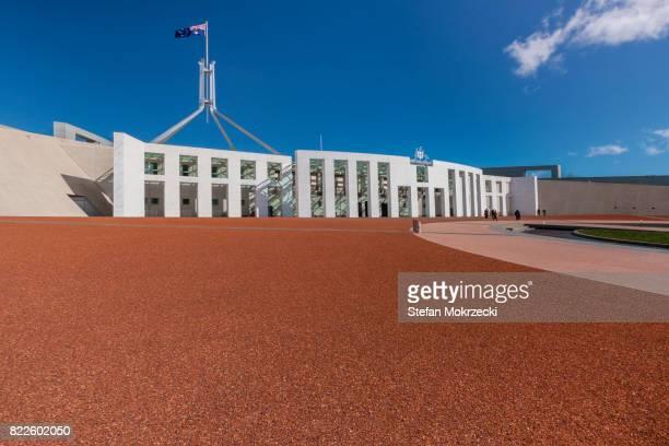 daytime view of parliament house, canberra, australia - オーストラリア国会議事堂 ストックフォトと画像