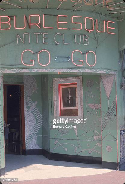 Daytime view of the entrance to a burlesque nightclub that offers gogo dancing Tijuana Mexico 1969