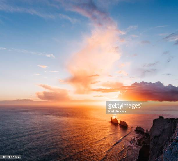 a daytime view of the needles lighthouse, isle of wight - stock photo - europe stock pictures, royalty-free photos & images