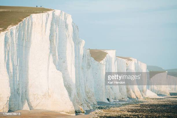 a daytime view of the seven sisters cliffs on the east sussex coast - stock photo - 炭酸石灰 ストックフォトと画像