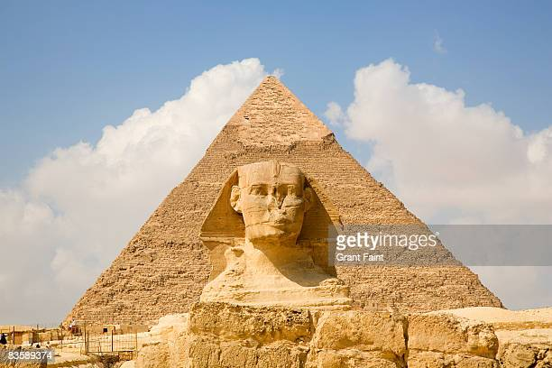 daytime view pyramid with sphinx foreground - giza pyramids stock pictures, royalty-free photos & images