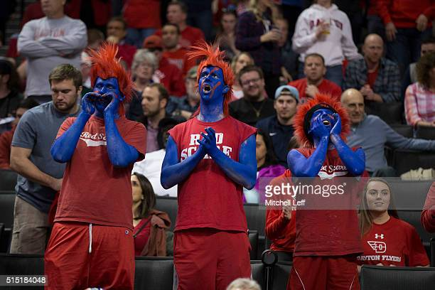 Dayton Flyers fans cheer from the stands during the game against the Saint Joseph's Hawks in the semifinals round of the men's Atlantic 10 tournament...