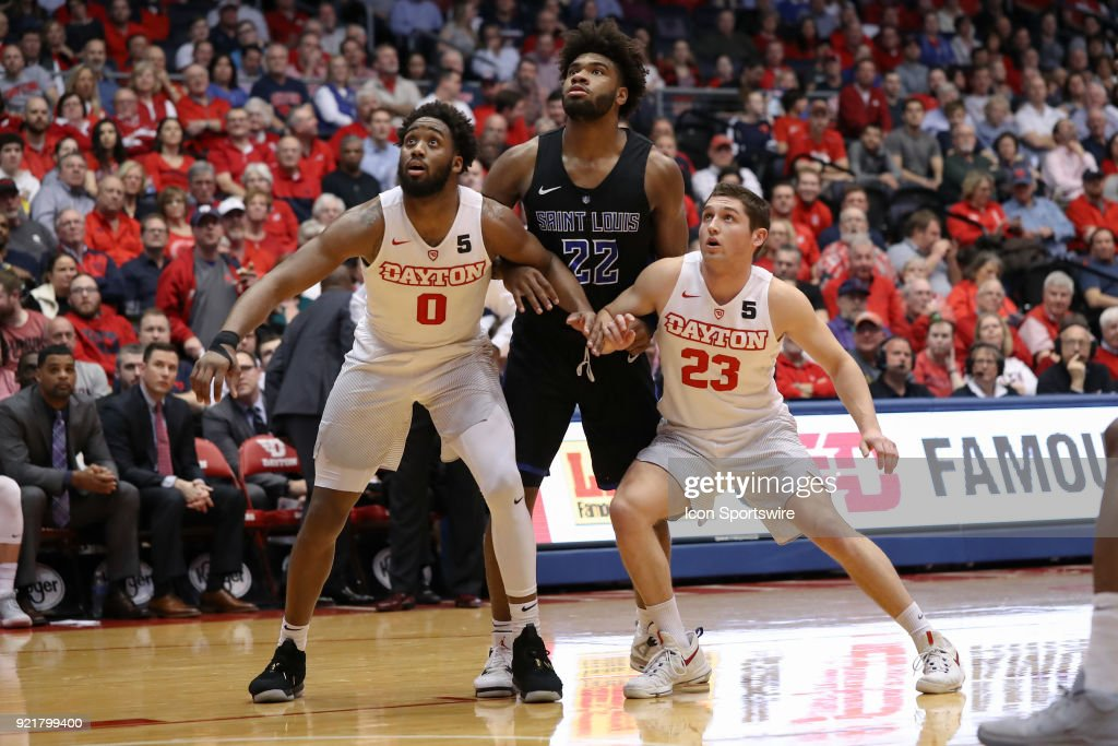 Dayton Flyers forward Josh Cunningham (0) and Dayton Flyers guard Jack Westerfield (23) box out Saint Louis Billikens forward Hasahn French (22) in a game between the Dayton Flyers and the Saint Louis Billikens on February 20, 2018 at University of Dayton Arena in Dayton, OH.