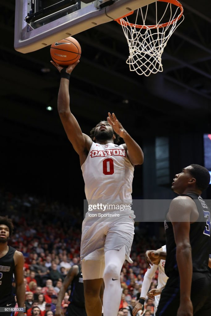 Dayton Flyers forward Josh Cunningham (0) attempts a layup in a game between the Dayton Flyers and the Saint Louis Billikens on February 20, 2018 at University of Dayton Arena in Dayton, OH. The Flyers won 53-50.