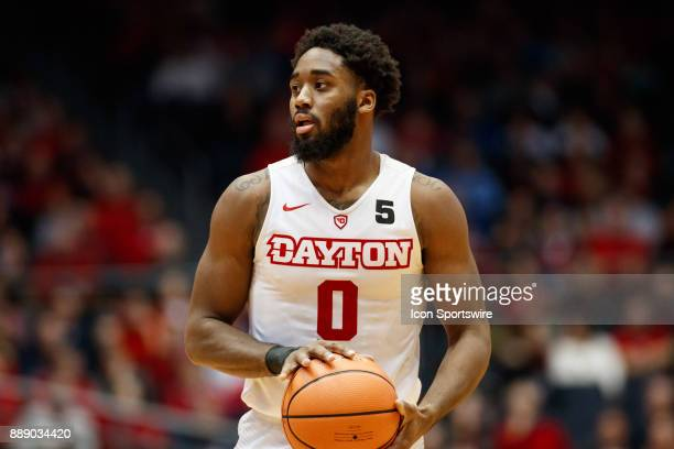 Dayton Flyers forward Josh Cunningham holds the ball waiting for an open man during the second half of a game between the Dayton Flyers and the...