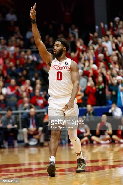 Dayton Flyers forward Josh Cunningham reacts after making a three point basket during the second half of a game between the Dayton Flyers and the...