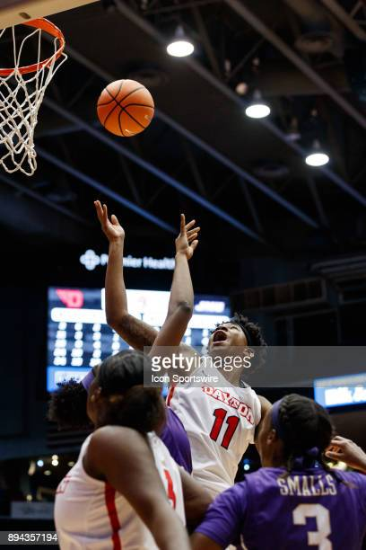 Dayton Flyers forward/center Alex Harris lays the ball up and is fouled during a game between the James Madison Dukes and the Dayton Flyers on...