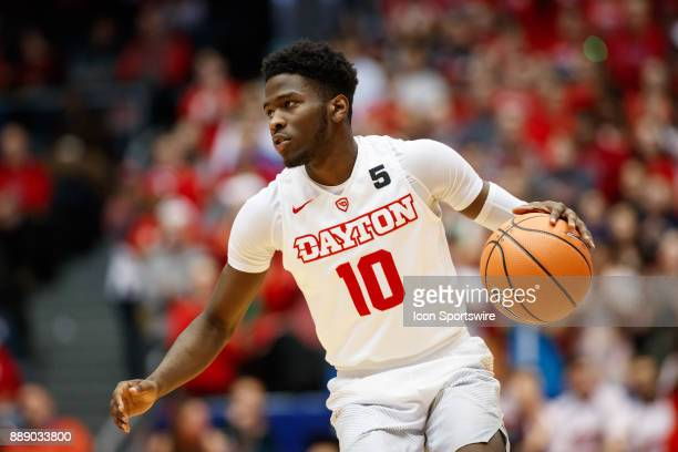 Dayton Flyers guard Jalen Crutcher dribbles the ball during the second half of a game between the Dayton Flyers and the Pennsylvania Quakers on...