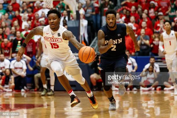 Dayton Flyers guard John Crosby dribbles the ball up court during the second half of a game between the Dayton Flyers and the Pennsylvania Quakers on...