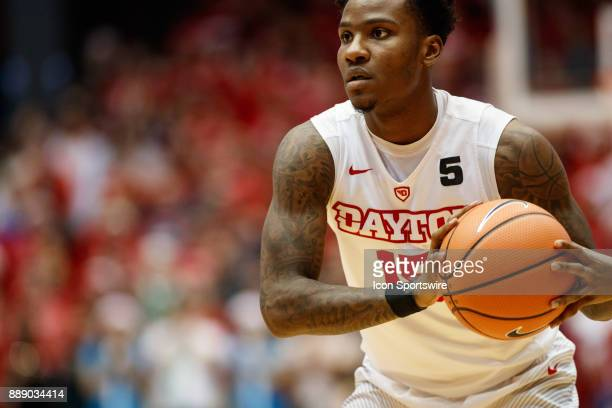 Dayton Flyers guard John Crosby looks to pass the ball during the second half of a game between the Dayton Flyers and the Pennsylvania Quakers on...