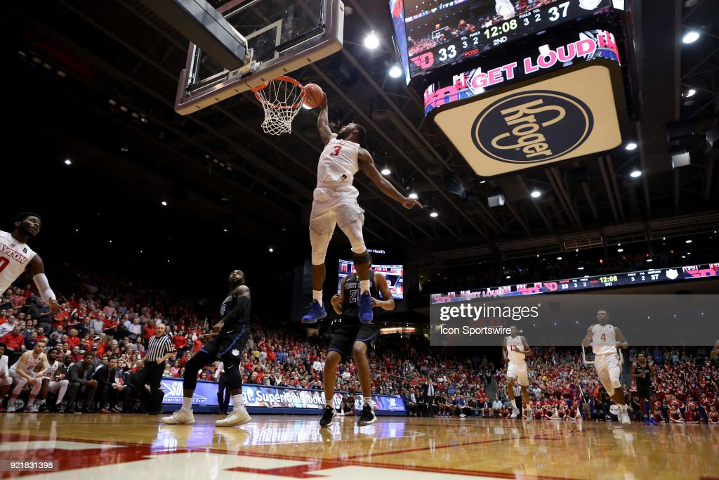 Dayton Flyers guard Trey Landers (3) receives a high pass from Dayton Flyers guard Jalen Crutcher (10) and dunks the ball in a game between the Dayton Flyers and the Saint Louis Billikens on February 20, 2018 at University of Dayton Arena in Dayton, OH. The Flyers won 53-50.