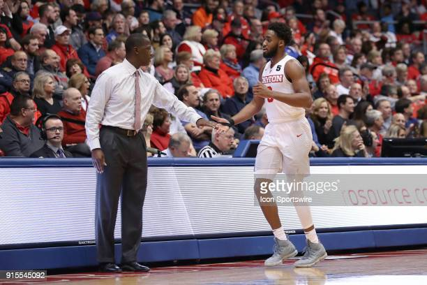 Dayton Flyers head coach Anthony Grant and Dayton Flyers forward Josh Cunningham shake hands in a game between the Dayton Flyers and the Duquesne...