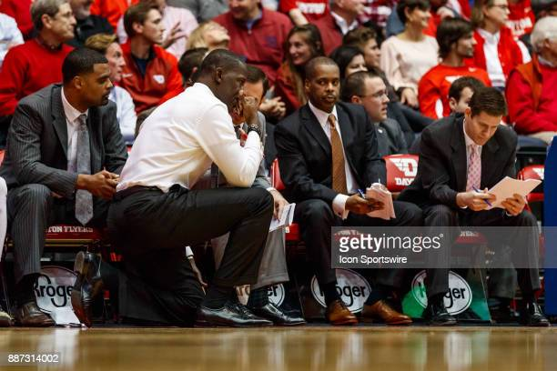 Dayton Flyers head coach Anthony Grant kneels during the second half of a game between the Dayton Flyers and the Tennessee Tech Golden Eagles at...