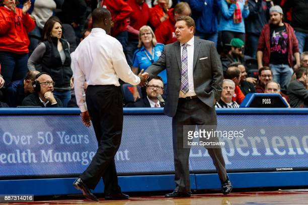 Dayton Flyers head coach Anthony Grant shakes hands with Tennessee Tech Golden Eagles head coach Steve Payne after the game between the Dayton Flyers...