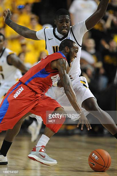 Dayton guard Kevin Dillard attempts to dribble past Virginia Commonwealth University forward Jarred Guest in the second half at the Stuart Siegel...