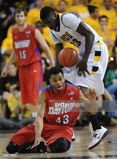 Dayton guard Vee Sanford and Virginia Commonwealth University forward Jarred Guest battle for a loose ball in the first half at the Stuart Siegel...