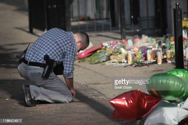 Dayton police officer returns to search for more evidence at the scene of Sunday Morning's mass shooting in the Oregon District on August 06 2019 in...