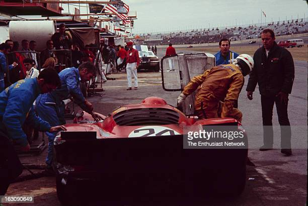 Daytona 24 Hour Race Mike Parkes of NART climbs out of his Ferrari 312P in the pits Parkes along with codriver Sam Posey will drive the Ferrari to a...