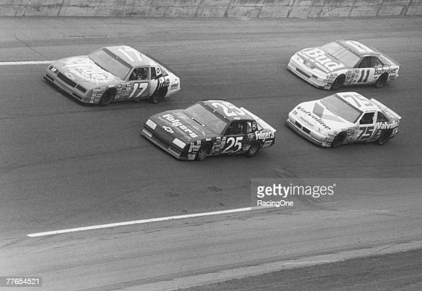 Daytona 500 winner Darrell Waltrip takes the high groove to lead Ken Schrader Morgan Shepherd and Rick Mast