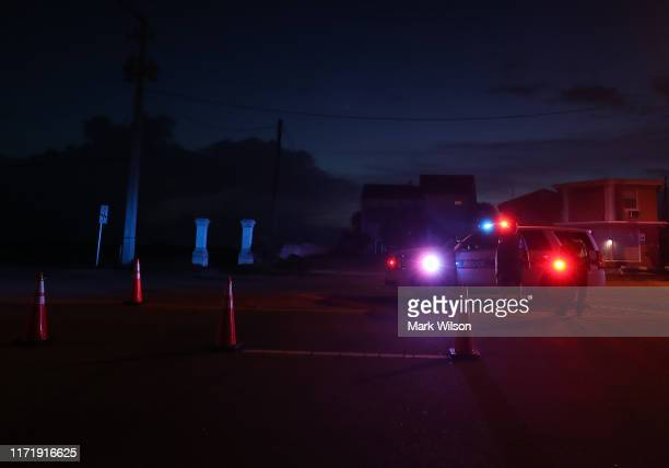 Daytona Beach Shores Police set up a road block to only let residents in as hurricane Dorian looms in the Atlantic Ocean on September 3 2019 in...
