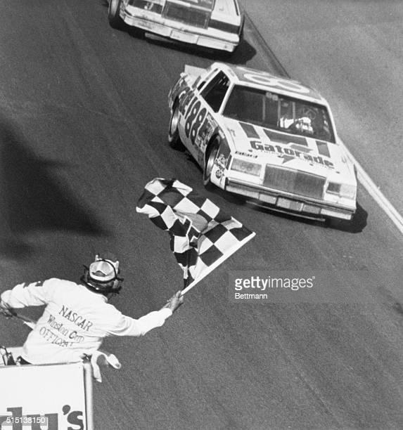 Daytona, Florida: Bobby Allison, Hueytown, Ala., takes the checkered flag to win the 24th Daytona 500. Allison piloted his Buick to victory over a...